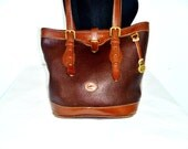 Vintage Dooney & Bourke™ All-Weather Leather® Brown on Brown Bucket Bag Purse with Buckling Straps
