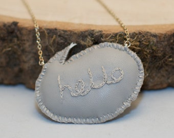 Hello speech bubble - stitched faux leather stuffie necklace - on silver coloured chain
