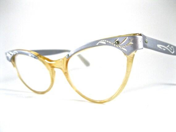 silver cat eye glasses. aluminum plastic combo frames w/