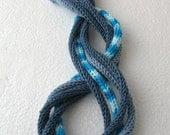 Knitted necklace in blue tones  E209