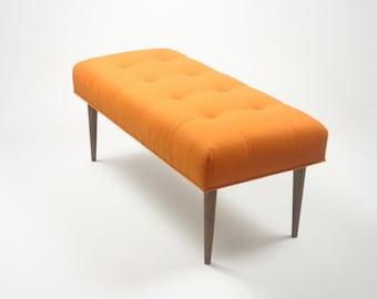 Modern upholstered bench in Knoll Felt in Tangerine