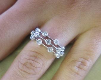 14K White gold Burnish set round diamonds ring.