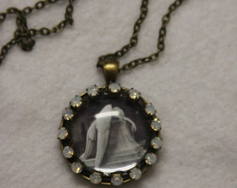 Mourning cemetery  angel sad ange 1 inch round glass bubble rhinestones necklace 24 in