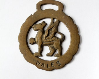 antique brass equestrian fixture, horse harness piece, Wales griffin