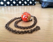 Orange globe necklace