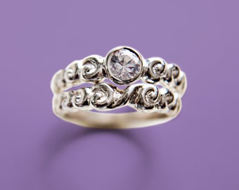 White sapphire spiral wedding ring set