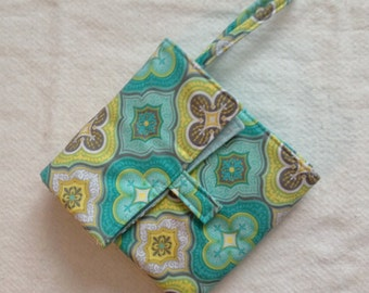 flip and go travel diaper changing pad/baby changing pad/travel diaper clutch with pockets - aqua/lime/gray geometric