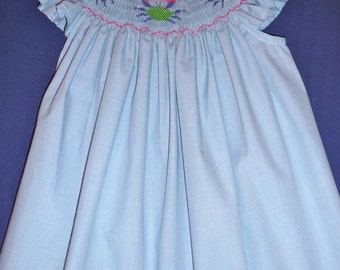 Smocked summer dress with green crabs.