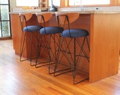 Industrial mid century modern metal bar stools, curved plywood backs.