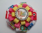 Yo Gabba Gabba Pink and Yellow Flower Hair Bow Clip with Bottle Cap Center
