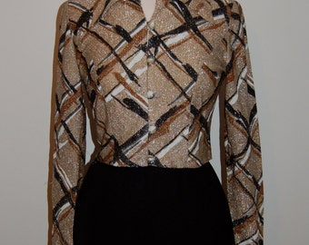 1950s Sparkly gold bolero/shirt with a black bronze and white criss cross patterm