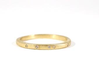 Teeny Diamond Specked Wedding Band in 14k Yellow Gold