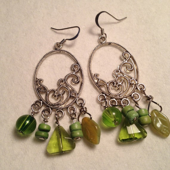 Silver plated earrings with light/lime green glass beads of various size and shape and ceramic donut beads