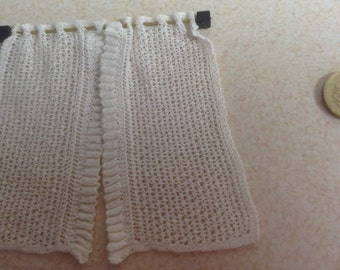 Hand knitted lace curtains for a dolls house