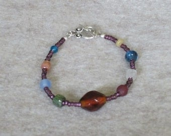Amethyst colored glass bead bracelet