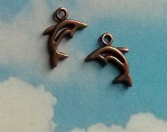 10 tiny dolphin charms, copper tone, 13mm