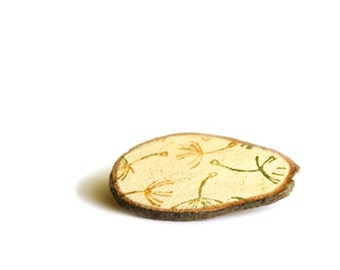 Wooden brooch  with dandelions in green and yellow on cream background