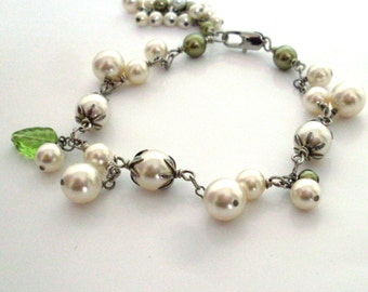 Ivory pearl dangle bracelet, ivory green pearls, green leaf dangle, antiqued silver wire wrapped, ivory green pearl bridal jewelry