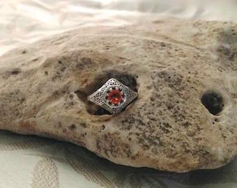 Edwardian White Gold Filigree Orange Sapphire Ring