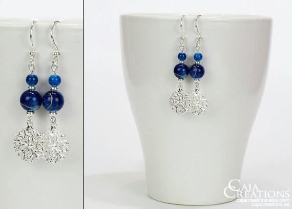 https://www.etsy.com/se-en/listing/175916338/wintery-ooak-blue-earrings-with