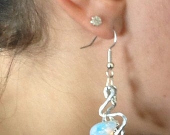 Hammered metal, silver dangle earrings with faux pearls and moonstone colored beads.