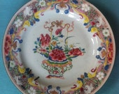 Antique Chinese hand painted Famille Rose porcelain plate floral basket motif, 5 wrapped wire repair staples!