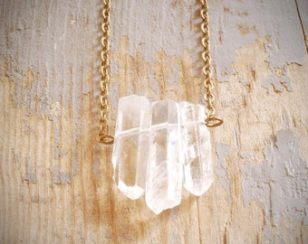 three crystals. triple clear natural quartz crystal wands grouped on fine antiqued brass chain by val b.