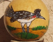 """Hand-Painted Gourd Christmas Ornament """"Roadrunner"""" Design by artist Sandy Short."""