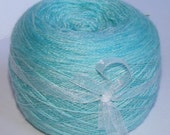 Blue Faced Leicester and Silk Laceweight yarn handpainted in shades of pale blue