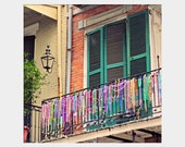 Beads on the Balcony: square fine art photograph print of colorful Mardi Gras beads, New Orleans architecture (Royal Street, French Quarter)