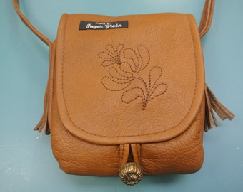 Unique one-of-a-kind handmade shoulder/handbag of light brown soft highquality skin/leather with a quilt flower decoration