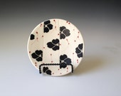 Porcelain small plate, dogwood pattern with red accents.