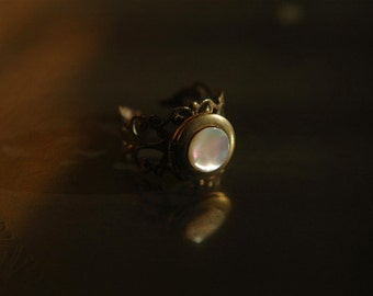 Adjustable vintage brass locket ring with iridescent mother of pearl cabochon