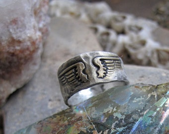 be nice ring in fine eco silver with wings and gold accent