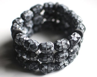 Statement bracelet, art jewelry, faceted beads, black and white