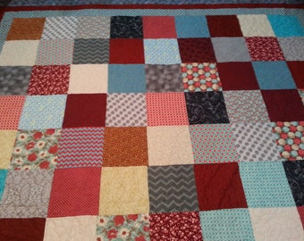 King size red, turquoise, grey and cream quilt