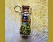 Fairy Castle in Tiny Glass Bottle Pendant .