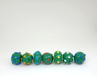 Green Rondelle and Round Beads with White Red Yellow Turquoise Orange  and Blue Polka Dots a Set of 7 Unique Polymer Clay Beads