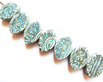 SILVERED COPPER TRIBE    7 copper green and silvered ivory matte finish zulus   A Beaded Gift