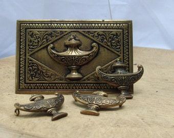 set of vintage alladin lamp buttons and belt buckle