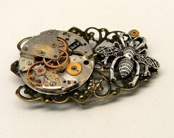 Steampunk bumble bee and vintage watch brooch. Steampunk jewelry.