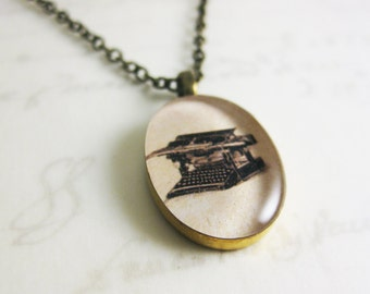 "Vintage Style Typewriter Illustration Necklace - Oval Resin Pendant in Black and White - 19"" bronze chain with matching clasps"