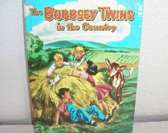 The Bobbsey Twins in the Country 1953 book with picture cover - family farm scene - illustrated vintage childrens book - mid century read