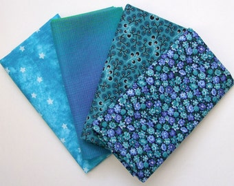 Set of four fat quarters in teal prints