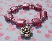 Dark Pink Foil Lined Glass Bead Bracelet with Flower Charm