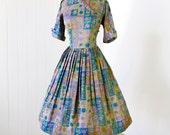 vintage 1950's dress ...pretty MEG MARLOWE floral novelty print assymetrical full skirt pin-up dress