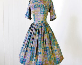 vintage 1950's dress ...pretty MEG MARLOWE floral novelty print assymetrical full skirt pin-up dress