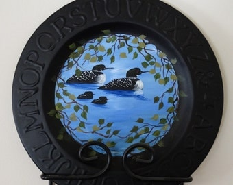 "Hand Hammared 9"" metal primitive abc plate, with hand painted loons,"
