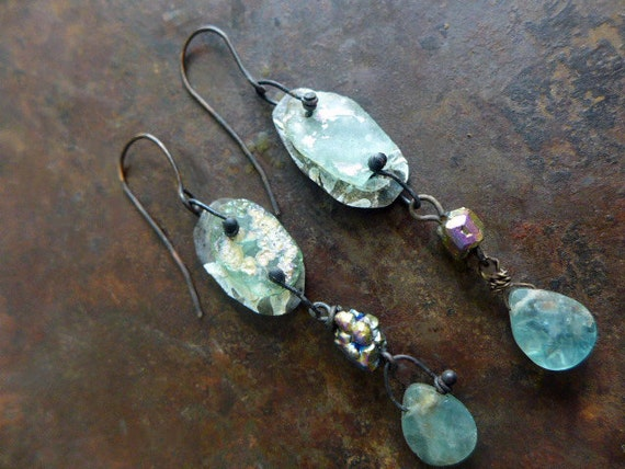 Of Shimmering Rains. Rustic victorian tribal assemblage earrings with Roman glass, apatite.