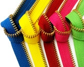 Zipperstop's Classic Brass Zipper Accents Five Junction YKK #5 Teeth consisting of 5 colors- Blue, Lemon Yellow, Red, Hot Pink, Spring Green